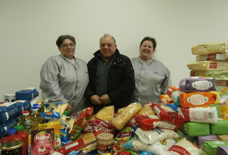 West food drive group shot of serbian employees collecting food