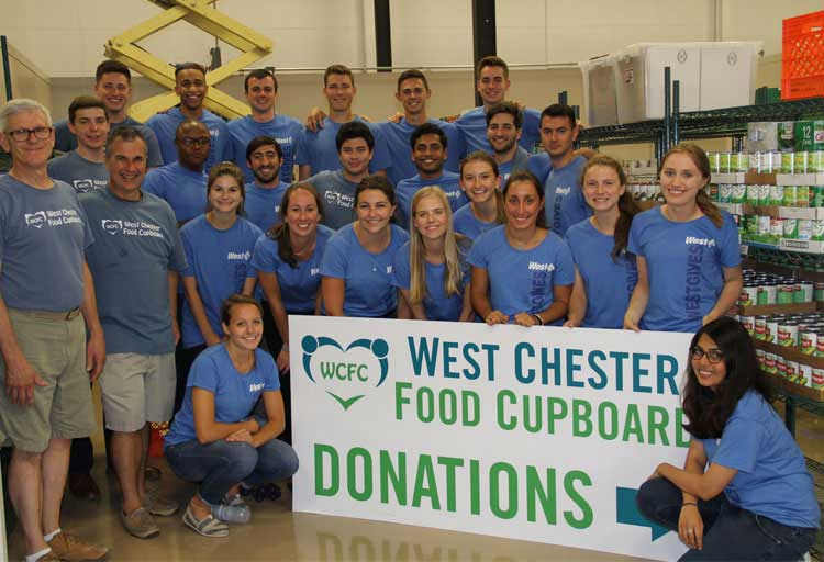Ambassador Interns participate in a Volunteer Day at the West Chester Food Cupboard.