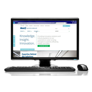 The New WestPharma Website on a computer with keyboard and mouse