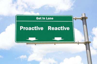 Green sign that says get in lane proactive reactive