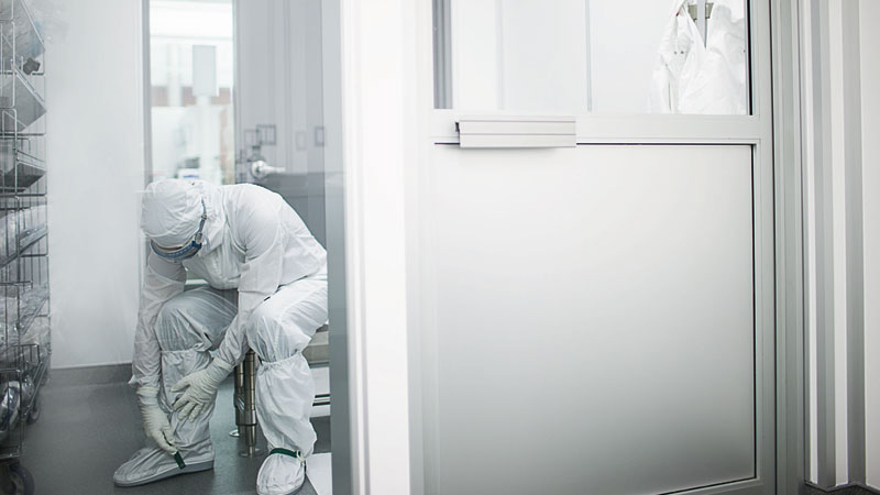 Scientist preparing to go into a clean room